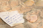Postcard in the sand — Stock Photo