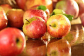 Apples on a wet table — Stock Photo