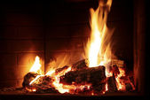 Burning fire in a fireplace — Stock Photo