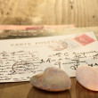 Stone hearts with postcard — Stock Photo #8178310