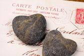 Stone hearts with postcard — Stockfoto