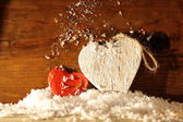 Wooden hearts in snow — Stock Photo