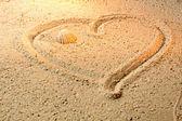 Heart shape in sand — Stock Photo