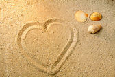 Heart shape in sand — Stock Photo