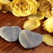 Stone hearts with roses - Stock Photo