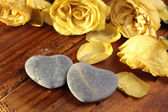 Stone hearts with roses — Stock Photo