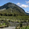 Stock Photo: Mountain range at Milford Road