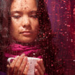 Thoughtful Asian woman in rainy weather — Stock Photo