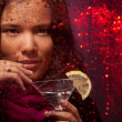 Стоковое фото: Attractive Asiwomwith drink in cold rainy weather