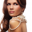 Yung woman with pearls necklace — Stock Photo #9629568