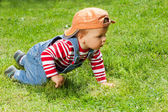 Toddler crawling in the garden — Stock Photo