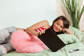 Watching movies from tablet computer — Stock Photo