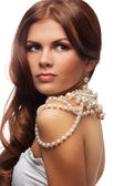 Yung woman with pearls necklace — Stock Photo