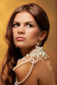 Girl with pearls necklace — Stock Photo
