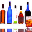 Stock Photo: Alcohol drink with bottles on background
