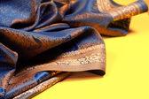 Beautiful fabric with golden lining — Stock Photo