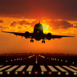 Airplane take off during sunset — Stock Photo