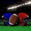 Football equipment on the field at night - Stock Photo