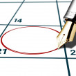 Calender date circled with red pen - Stock Photo