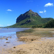 Stock Photo: Le Morne Brabant mountain, as seen from Le Morne village