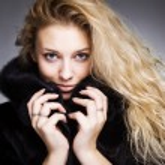 Fashionable woman in black fur — Stock Photo #8247856