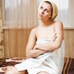 Woman wearing yellow bath towel — Stock Photo #8247887