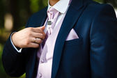 Groom set the tie — Stock Photo