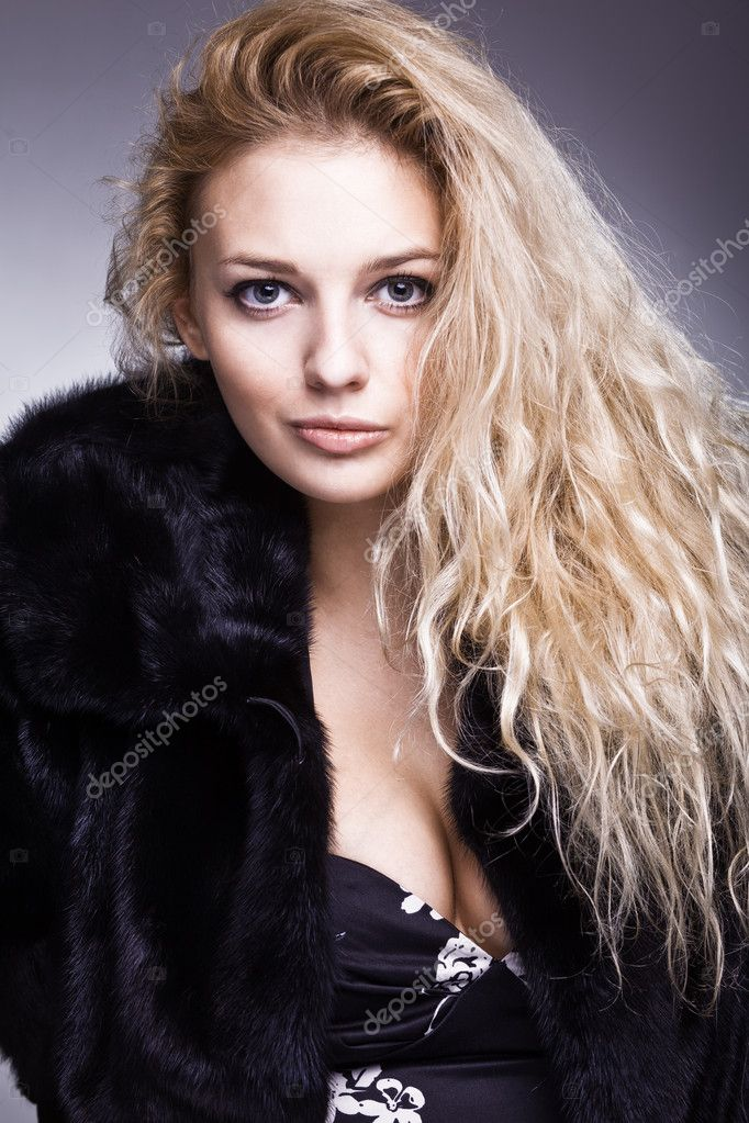 Beautiful fashionable woman in black fur  Stock Photo #8396258