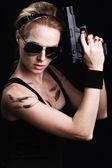 Woman posing with gun — Stock Photo