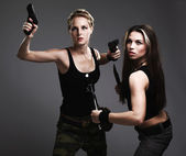 Sexy women with gun and dagger — Stock Photo