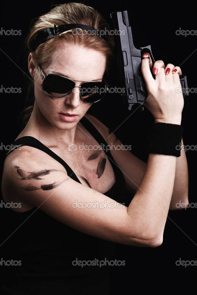 Shot of a sexy military woman posing with gun — Stock Photo #8871471
