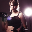 Young woman doing her workout welghtlifting dumbbell — Stock Photo