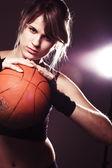 Female basketball player holding ball — Stock Photo