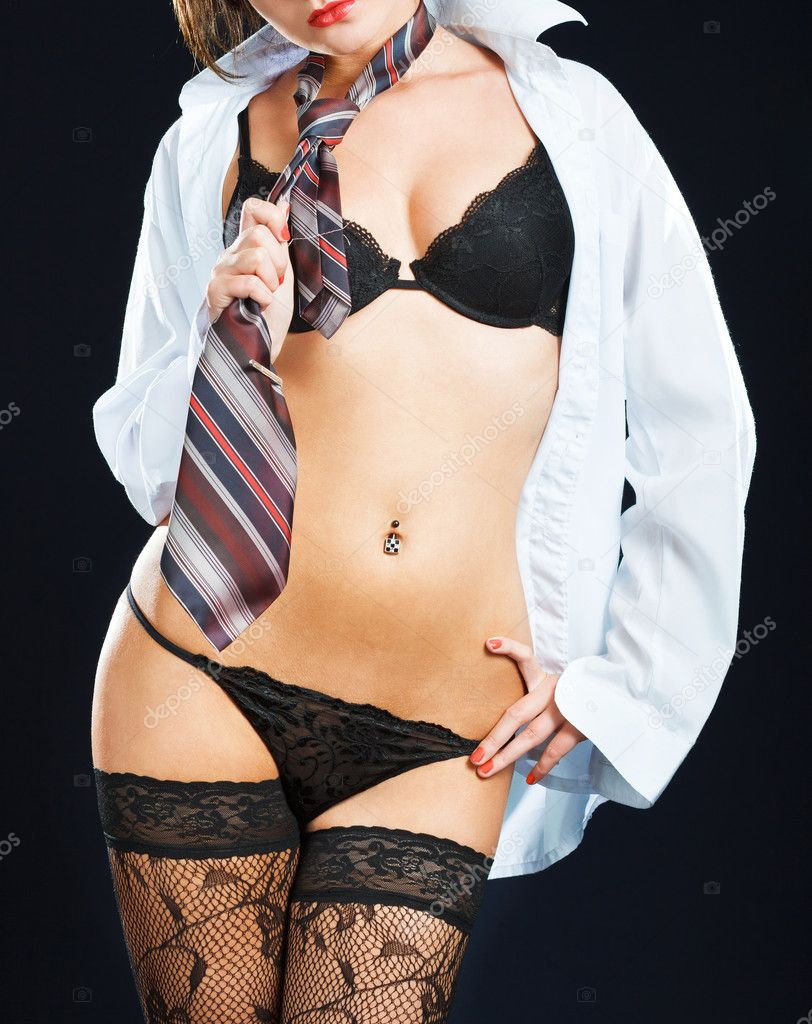 Sexy woman in erotic lingerie over dark background — Stock Photo #9914955