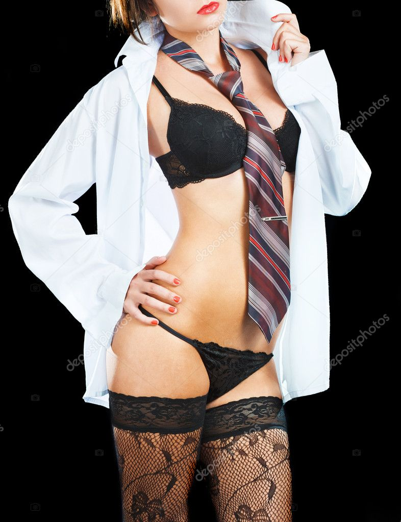 Sexy woman in erotic lingerie over dark background — Stock Photo #9914968