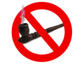 Wooden carved smoking pipe with prohibitory sign — Stock Photo