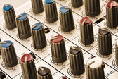 Controllers of audio mixing console close-up. — Stock Photo