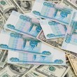 Background from dollars and Russian rubles — Stok fotoğraf