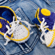 Stock Photo: Knitting gym shoes for newborn