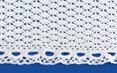 Knitting white lace — Stock Photo