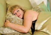 Elderly woman rests in bed — Stock Photo