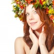 Red haired woman with flower wreath on head — Stock Photo