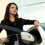 Woman standing near car — Stock Photo