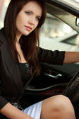 Brunette woman in car — Stock Photo