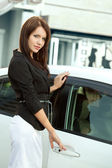 Woman near car — Stock Photo