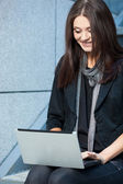 Woman working with laptop outdoors — Stock Photo