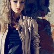 Beautiful blond woman wearing leather jacket — Stock Photo