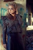 Beautiful blond woman near old wall — Stock Photo