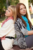 Two sisters dreaming in the park — Stock Photo