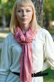 Blond woman near tree — Stock Photo